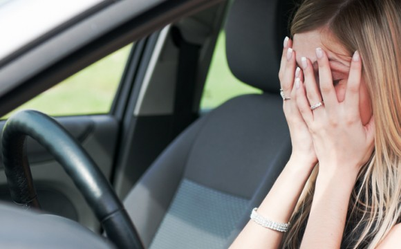 Troubles - unhappy woman in car
